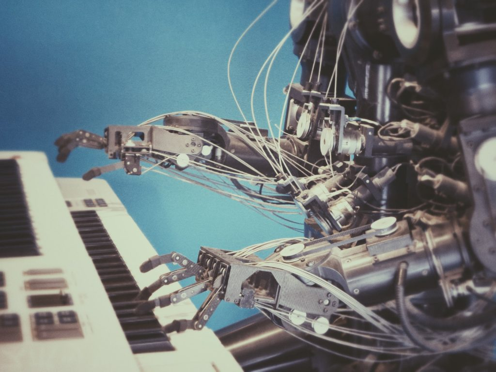 machine clicks, a robot playing a piano